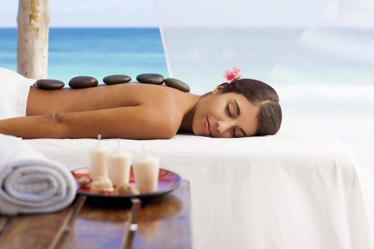 Woman enjoying a massage by the beach