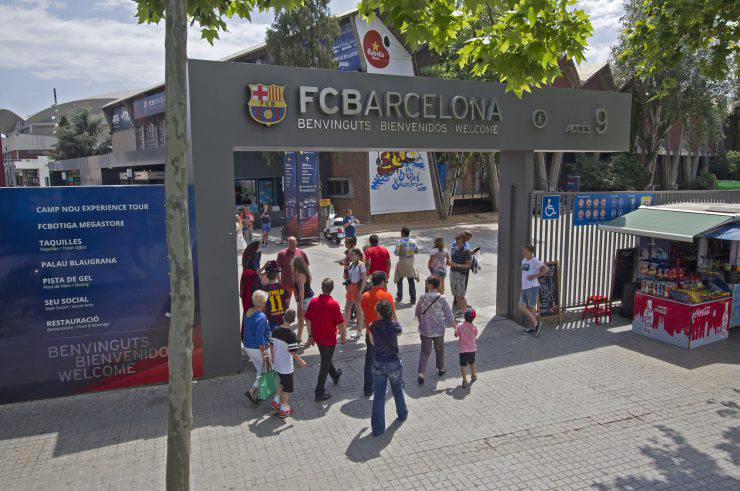 Barcelona, Spain - May 25 2015: Tourists enter the gate of the stadium of FC Barcelona in Barcelona in Spain on May 25 2015.