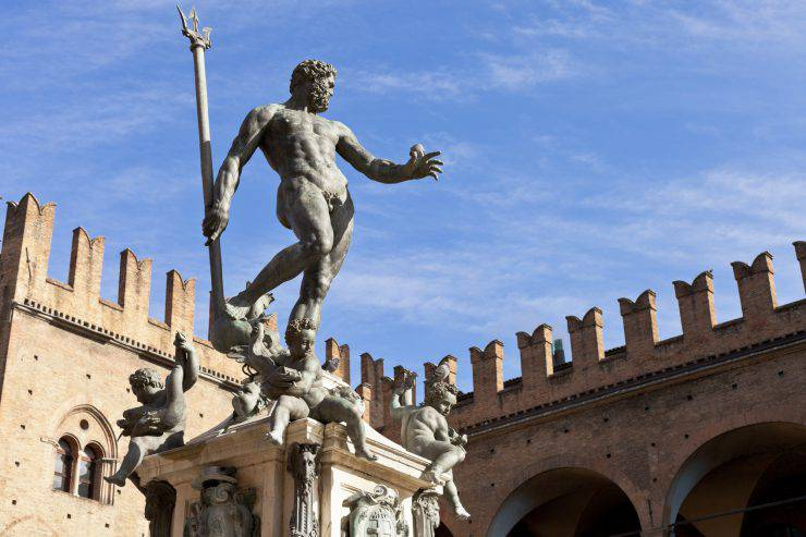Statue of Neptune on Piazza del Nettuno in Bologna in sunny day, Italy