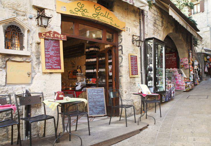San Marino Citta, San Marino - October 5, 2011: Narrow lane with local restaurants and souvenir shops in the old centre of San Marino capital on Monte Titano