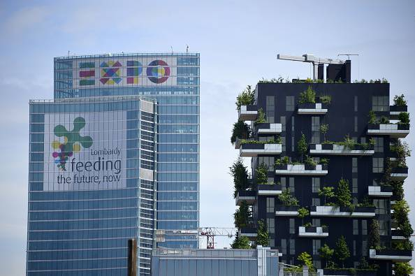 A picture shows the Lombardia Region building advertising EXPO2015 on April 28, 2015 in Milan where the World Exposition Milano 2015 (Universal Exposition) will run from May 1st, 2015 to October 31, 2015 on the theme Feeding the Planet, Energy for Life. The fair focuses on food security, sustainable agricultural practices, nutrition and battling hunger - as well as on dishing out the best fare of the world's culinary cultures. Cooking shows, restaurants, and food stalls will be designed to attract and hold visitors in Italy's financial capital. AFP PHOTO / OLIVIER MORIN        (Photo credit should read OLIVIER MORIN/AFP/Getty Images)