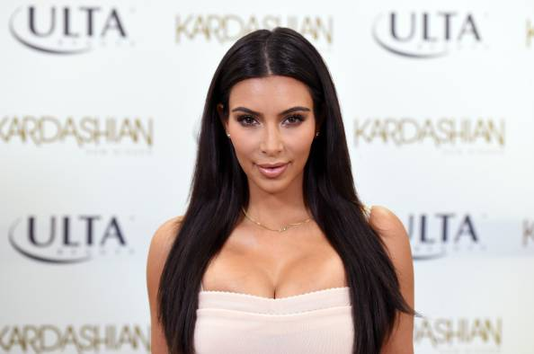 LOS ANGELES, CA - AUGUST 06:  Kim Kardashian celebrates summer with the Kardashian Sun Kissed line and fans at ULTA Beauty on August 6, 2014 in Los Angeles, California.  (Photo by Jason Merritt/Getty Images)