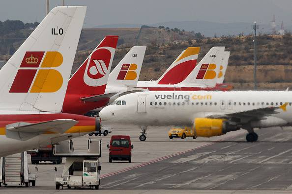 MADRID, SPAIN - FEBRUARY 11:  Planes are parked as a Vueling plane arrives at Madrid Barajas Adolfo Suarez airport which is operated by group Aena on February 11, 2015 in Madrid, Spain. Shares in state-controlled Spanish airports operator, Aena, began trading today on the Madrid stock market. The Spanish government will retain a 51% controlling share in the firm, as it seeks to raise 3.9 billion Euros through the sale of the remaining 49%. Aena operates major hubs in Barcelona and Madrid, as well as a further 15 airports in Europe and America, including London Luton.  (Photo by Pablo Blazquez Dominguez/Getty Images)
