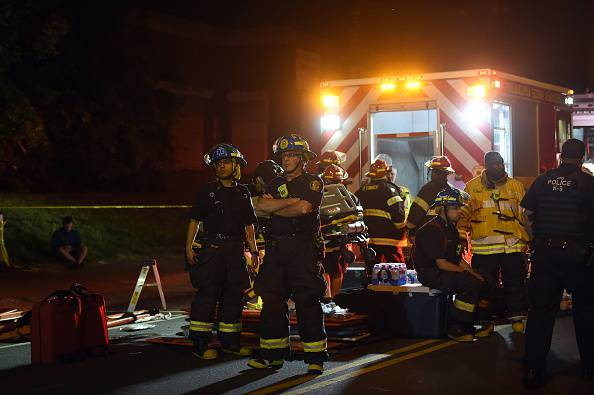 Emergency personnel wait near an Amtrak train crash site in Philadelphia, Pennsylvania, on May 13, 2015.  At least five people were killed and dozens injured after an Amtrak train derailed and overturned in Philadelphia late May 12, 2015.     AFP PHOTO /JEWEL SAMAD        (Photo credit should read JEWEL SAMAD/AFP/Getty Images)