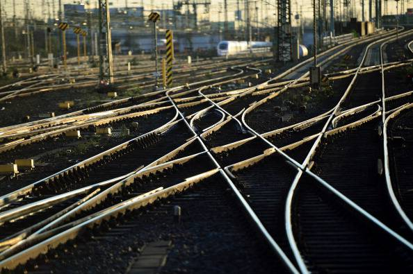 FRANKFURT AM MAIN, GERMANY - MARCH 20:  The sun reflects off train tracks at a railway junction on March 20, 2014 in Frankfurt, Germany. Deutsche Bahn, Europe's biggest rail carrier, is scheduled to announce financial results for 2013 on March 27.  (Photo by Thomas Lohnes/Getty Images)