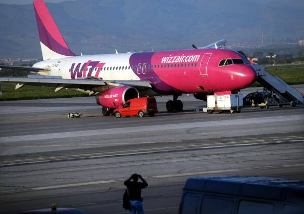 This picture taken on May 1, 2010, shows a  plane from low-cost eastern European carrier Wizzair which caught fire as it came to land at Sofia Airport. All 146 passengers on board escaped harm, the Bulgarian government announced.  A front wheel of the Airbus A-320 arriving from Venice burst and caught alight, the interior ministry said. AFP PHOTO / NIKOLAY DOYCHINOV (Photo credit should read NIKOLAY DOYCHINOV/AFP/Getty Images)