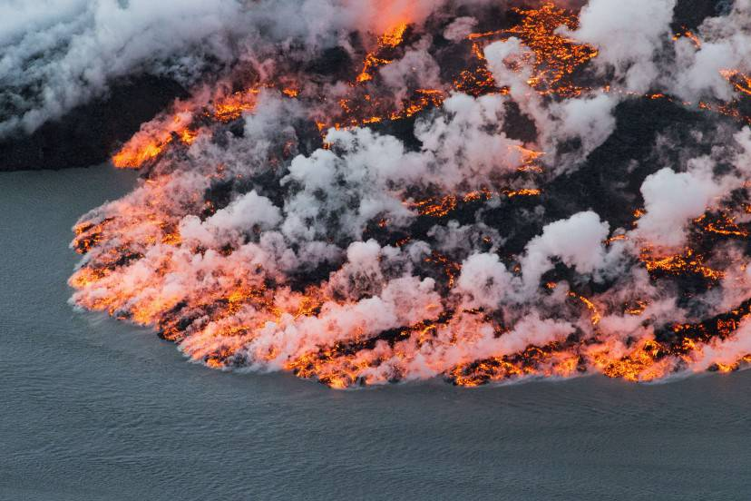 An aerial picture taken on September 14, 2014 shows lava flowing out of the Bardarbunga volcano in southeast Iceland. The Bardarbunga volcano system has been rocked by hundreds of tremors daily since mid-August, prompting fears the volcano could explode. Bardarbunga, at 2,000 metres (6,500 feet), is Iceland's second-highest peak and is located under Europe's largest glacier, Vatnajoekull. AFP PHOTO /  BERNARD MERIC        (Photo credit should read BERNARD MERIC/AFP/Getty Images)