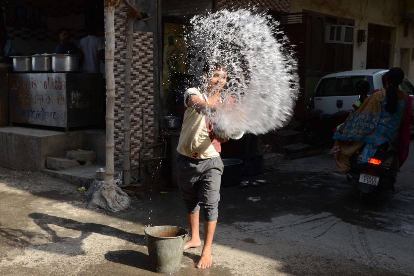 An Indian worker throws water outside a resteraunt in Amritsar on May 26, 2015, in an attempt to keep the pavement cool on a hot day.  At least 800 people have died in a major heatwave that has swept across India, melting roads in New Delhi as temperatures neared 50 degrees Celsius (122 Fahrenheit).    AFP PHOTO/NARINDER NANU        (Photo credit should read NARINDER NANU/AFP/Getty Images)