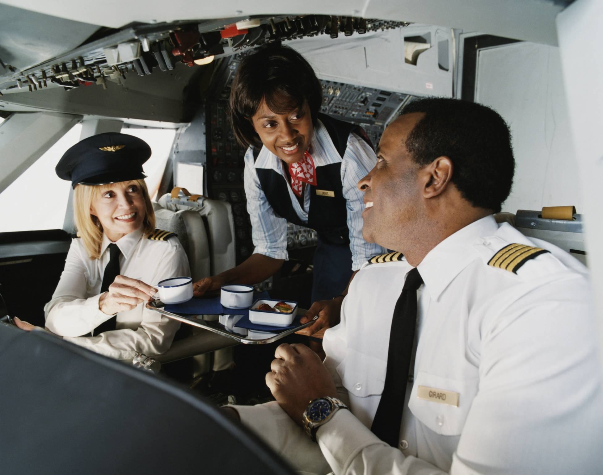 Air Hostess Serves Coffee to the Pilots in the Cockpit