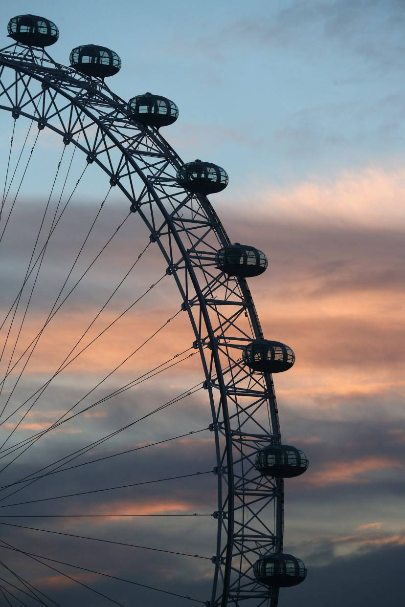 LONDON, ENGLAND - JANUARY 16:  The London Eye Ferris wheel, located on the South bank of the river Thames, rotates at dusk on January 16, 2013 in London, England.  (Photo by Oli Scarff/Getty Images)