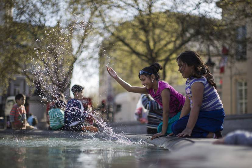 LONDON, ENGLAND - APRIL 14:  Children including Faiza Humayra, 10 from London (in pink) play on one of the Fountains in Trafalgar Square on April 14, 2015 in London, England. Today has been the hottest day of the year with temperatures reaching 24C in some parts of the country.  (Photo by Dan Kitwood/Getty Images)