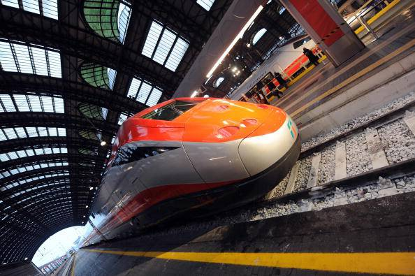 "A ""Freccia Rossa"" (Red Arrow) high speed train is at quay on the day of its launching on December 13, 2008 at Milan Central station. The Freccia Rossa high speed train of Italian company Trenitalia will reduce the travel time from Milan to Rome to three-hour and a half from December14 and to three-hour at the end of 2009.   AFP PHOTO / GIUSEPPE CACACE (Photo credit should read GIUSEPPE CACACE/AFP/Getty Images)"