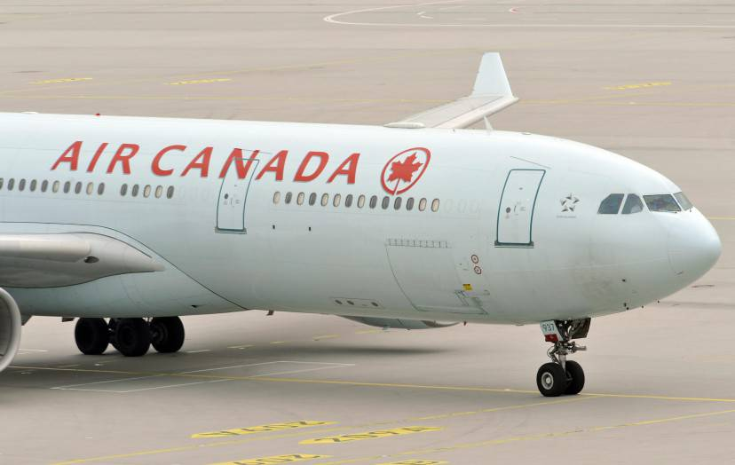 The plane of Air Canada, with German-Canadian arm dealer Karlheinz Schreiber on board, arrives at the airport of Munich, southern Germany on August 3, 2009. The 75-year-old will have to face tax evasion and bribery charges following a decade-long battle to avoid extradition, authorities said. Schreiber is accused of playing a key role in a sprawling slush-fund scandal that rocked the Christian Democratic Union (CDU) party in the 1990s and tarnished the legacy of former chancellor Helmut Kohl. AFP PHOTO  DDP/   JOERG KOCH      GERMANY OUT (Photo credit should read JOERG KOCH/AFP/Getty Images)