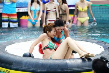 """This picture taken on June 2, 2013 shows participants of a """"Miss Bikini""""  beauty contest at a waterpark in Guangzhou, south China's Guangdong province. Girls wearing bikini play boxing during the contest.   CHINA OUT     AFP PHOTO        (Photo credit should read STR/AFP/Getty Images)"""