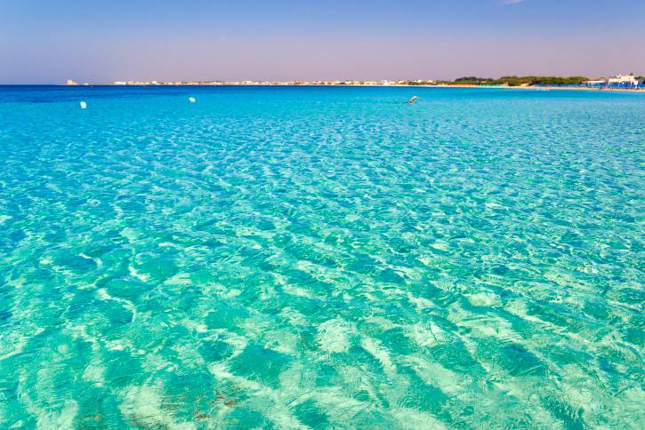 SUMMER.Colors of Apulia:swim in the morning(Salento coast,Lecce).- ITALY(Apulia)-