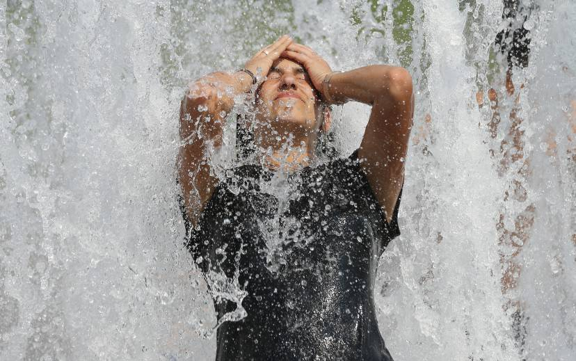 BERLIN, GERMANY - JUNE 20:  A young woman from Brazil cools off in a fountain on a scorching hot summer day in the city center on June 20, 2013 in Berlin, Germany. Central Europe is in the grips of a heat wave in which temperatures in some regions have reached up to 38 degrees celsius.  (Photo by Sean Gallup/Getty Images)