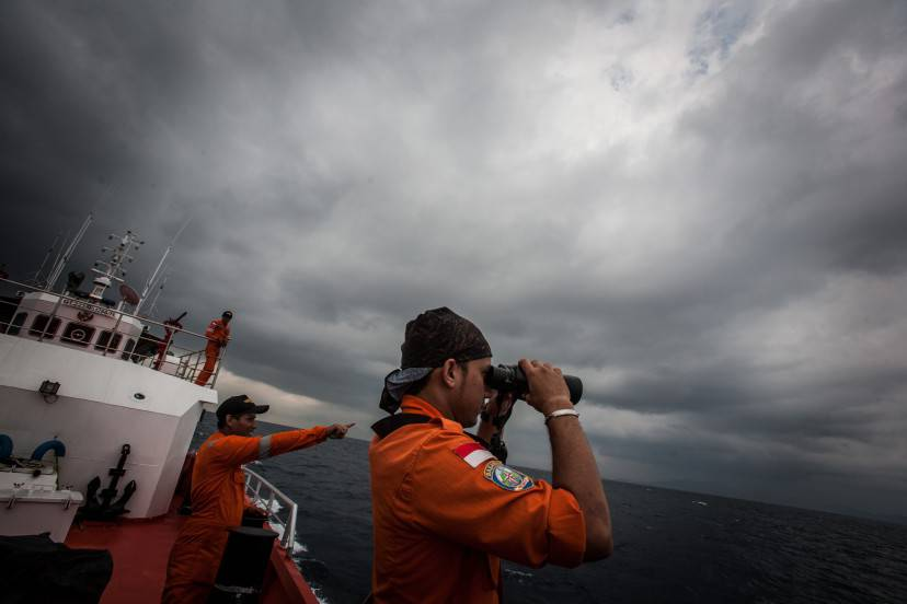 "Indonesian national search and rescue agency personel watch over high seas during a search operation for missing Malaysia Airlines flight MH370 in the Andaman Sea on March 15, 2014. Investigators now believe a Malaysian jet that vanished was commandeered by a ""skilled, competent"" flyer who piloted the plane for hours, a senior Malaysian military official said on March 15 as Prime Minister Najib Razak prepared to address the nation. AFP PHOTO/ Chaideer MAHYUDDIN        (Photo credit should read CHAIDEER MAHYUDDIN/AFP/Getty Images)"