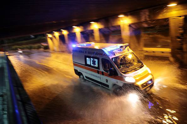 An ambulance drives down a flooded street in downtown Florence late on August 1, 2015. Some twenty people were wounded on August 1 when a tornado accompanied by heavy rains hit Florence, the Tuscan capital, and caused interruptions in the circulation of trains to Rome.  AFP PHOTO / CLAUDIO GIOVANNINI        (Photo credit should read CLAUDIO GIOVANNINI/AFP/Getty Images)
