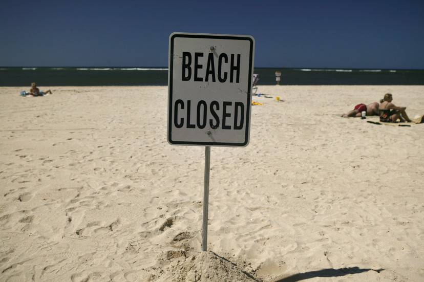 HONOLULU, HI - APRIL 3:   A closed beach sign is posted on Ft. DeRussy Beach in Waikiki Beach April 3, 2006 in Honolulu, Hawaii. With near perfect weather across Oahu, Waikiki Beach is near empty of swimmers due to the sewage spill which diverted millions of gallons of raw sewage into a nearby canal last week. High levels of bacteria were detected in the water forcing the Hawaiian Department of Health to close several of Waikiki's most famous beaches.  Warning signs were posted along most of Waikiki in English and Japanese.  (Photo by Marco Garcia/Getty Images)