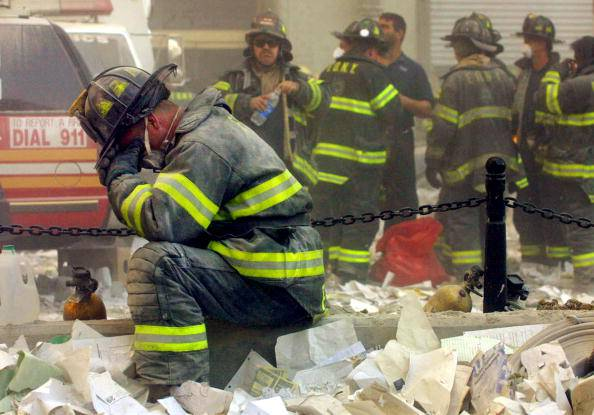 NEW YORK - SEPTEMBER 11, 2001: (SEPTEMBER 11 RETROSPECTIVE) A firefighter breaks down after the World Trade Center buildings collapsed September 11, 2001 after two hijacked airplanes slammed into the twin towers in a terrorist attack. (Photo by Mario Tama/Getty Images)