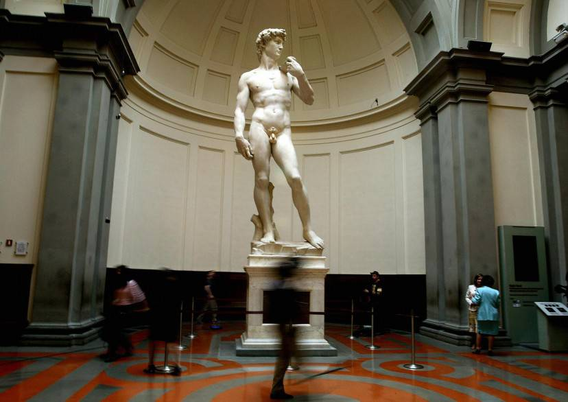 "FLORENCE, ITALY:  Michelangelo's famous marble statue of ""David"" is pictured at the Florence's Accademia Gallery 24 May 2004. The statue of ""David"" has been cleaned up ahead of its 500th anniversary in September 2004. The restoration resumed in September after an aborted start when the original restorer quit in a dispute over how the statue should be cleaned.   AFP PHOTO/Vincenzo PINTO  (Photo credit should read VINCENZO PINTO/AFP/Getty Images)"