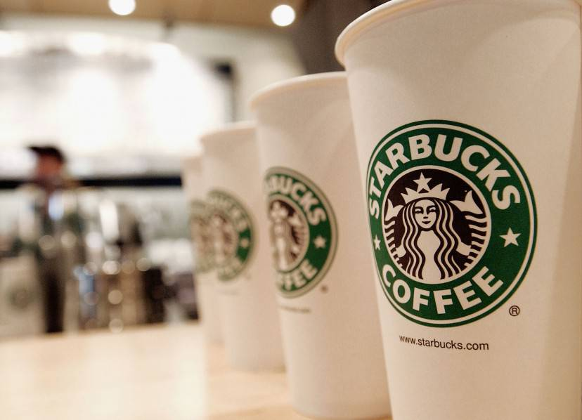 NEW YORK - AUGUST 5:  Beverage cups featuring the logo of Starbucks Coffee are seen in the new flagship store on 42nd Street August 5, 2003 in New York City. The Seattle-based coffee company has emerged as the largest food chain in the Manhattan borough of New York with 150 outlets.  (Photo by Stephen Chernin/Getty Images)