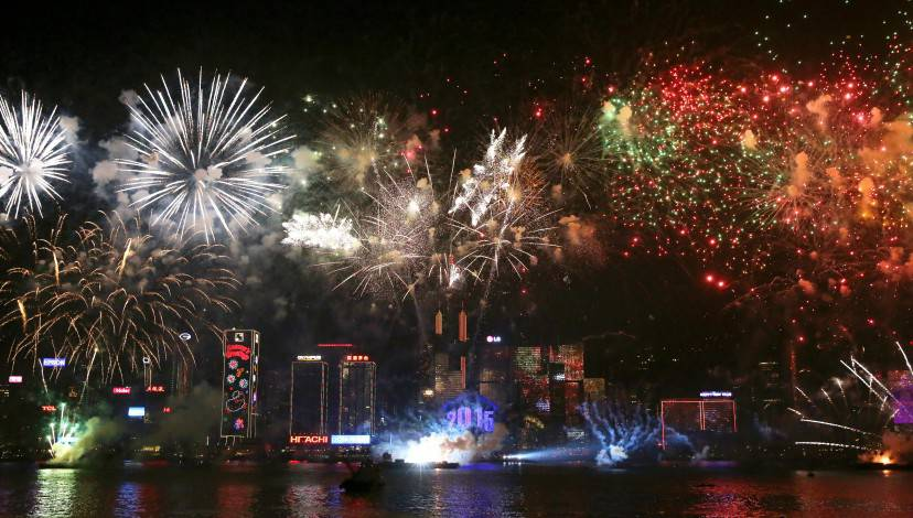 Fireworks explode over Victoria Harbour in Hong Kong on January 1, 2015. Just like previous years, the city's iconic skyline along Victoria Harbour will light up with an eight-minute pyrotechnic display, as tens of thousdands of partygoers will flock to the waterfront to celebrate.    AFP PHOTO / ISAAC LAWRENCE        (Photo credit should read Isaac Lawrence/AFP/Getty Images)