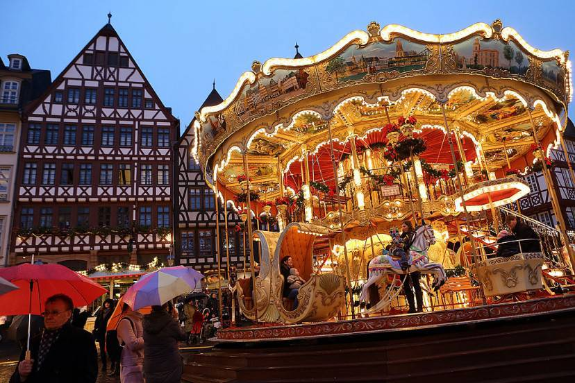 FRANKFURT, GERMANY - NOVEMBER 26:  People ride a carousel at the annual Christmas market in the city center on its opening day on November 26, 2012 in Frankfurt, Germany. Christmas markets, with their stalls selling mulled wine, Christmas tree decorations and other delights, are an integral part of German Christmas tradition, and many of them opened across Germany today. (Photo by Hannelore Foerster/Getty Images)