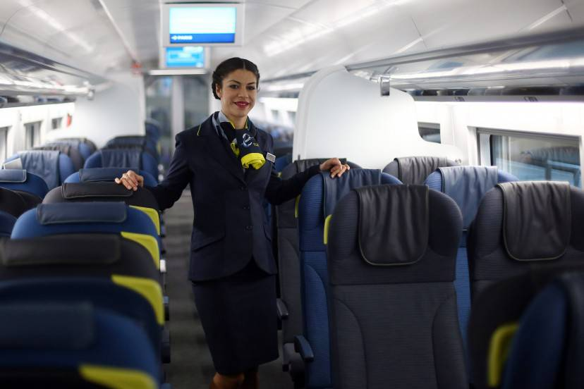 LONDON, ENGLAND - NOVEMBER 13: A stewardess poses for photographs on board Eurostar's new e320 train at St Pancras Station on November 13, 2014 in London, England. Launched today, the trains can reach speeds of up to 200mph and will get to Paris 15 minutes quicker than current trains. (Photo by Carl Court/Getty Images)