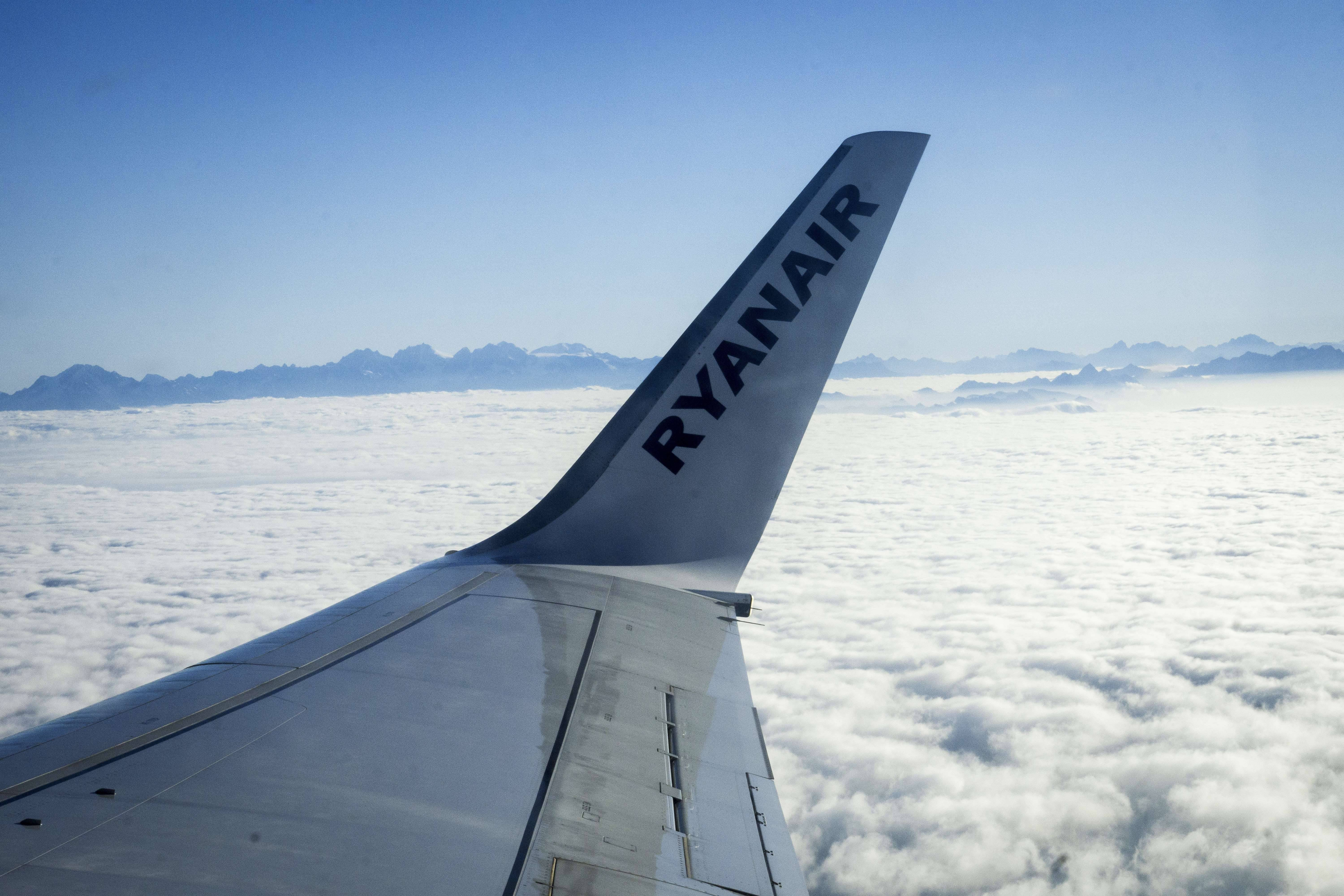 A picture shows the logo of Irish low-cost carrier Ryanair on the wing of a plane flying over the Italian Alps on July 1, 2015. AFP PHOTO / OLIVIER MORIN (Photo credit should read OLIVIER MORIN/AFP/Getty Images)