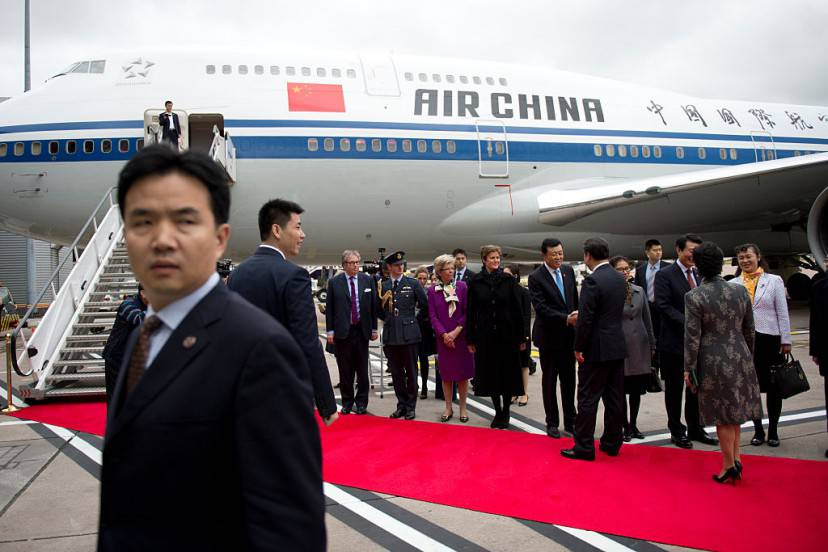 MANCHESTER, ENGLAND - OCTOBER 23:  President of the People's Republic of China Xi Jinping and his wife Peng Liyuan greet dignitaries before boarding an Air China plane at Manchester airport at the end of their state visit to Britain on October 23, 2015 in Manchester, England. The President of the People's Republic of China, Mr Xi Jinping and his wife, Madame Peng Liyuan, are paying a State Visit to the United Kingdom as guests of The Queen.  They will stay at Buckingham Palace and undertake engagements in London and Manchester. The last state visit paid by a Chinese President to the UK was Hu Jintao in 2005.  (Photo by Oli Scarff - WPA Pool/Getty Images)