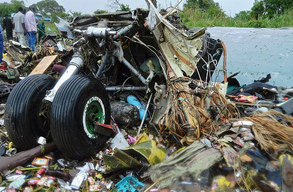 GRAPHIC CONTENT Victims' bodies are pictured under the landing gear at the site where a cargo plane crashed into a small farming community on a small island in the White Nile river, close to Juba airport in the Hai Gabat residential area, on November 4, 2015. At least 25 people were killed on November 4 when a plane crash-landed shortly after taking off from South Sudan's capital Juba, an AFP reporter said. AFP PHOTO/Samir bol (Photo credit should read SAMIR BOL/AFP/Getty Images)