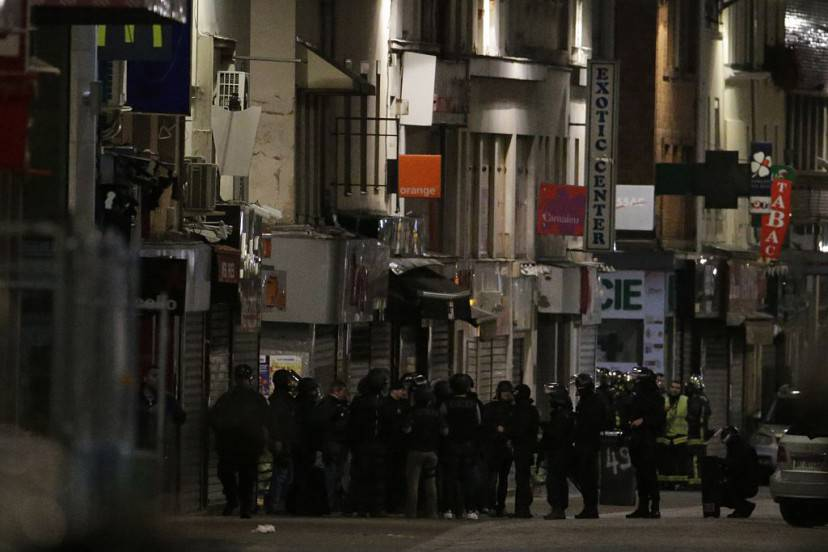 French Police special forces raid an appartment, hunting those behind the attacks that claimed 129 lives in the French capital five days ago, in the northern Paris suburb of Saint-Denis city center, on November 18, 2015. At least one person was killed in an apartment targeted in the operation aimed at the suspected mastermind of the attacks, Belgian Abdelhamid Abaaoud, and police had been wounded in the shootout. AFP PHOTO / KENZO TRIBOUILLARD        (Photo credit should read KENZO TRIBOUILLARD/AFP/Getty Images)