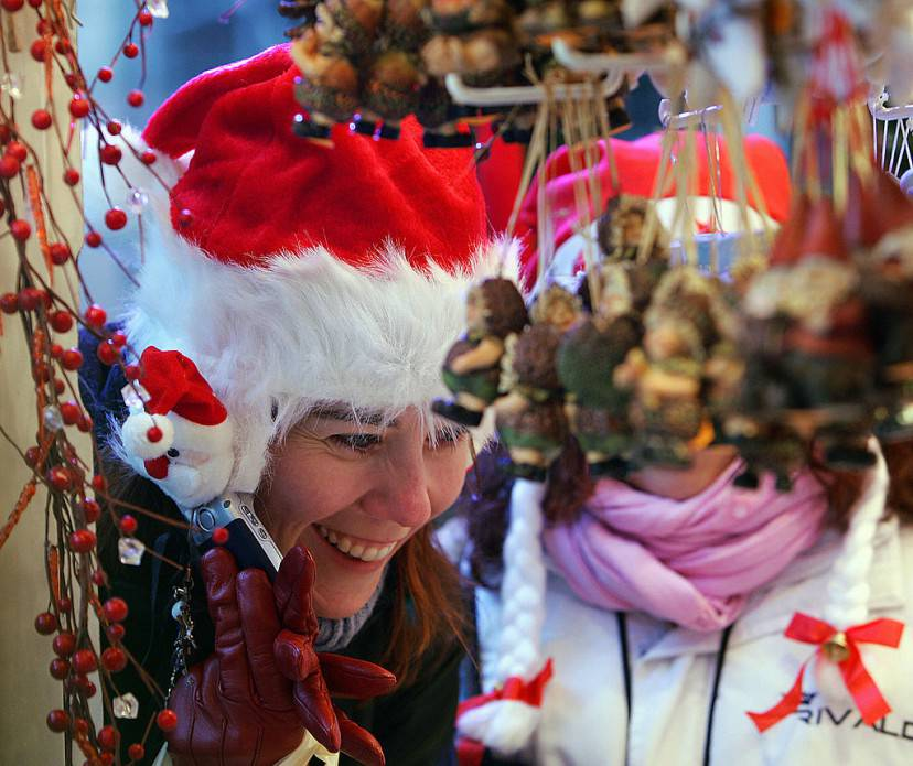 A tourist looks at Christmas decorations 24 November 2007 during the opening to the public of the Strasbourg Christmas market, which is the largest and one of the oldest French Christmas markets and attracts thousands of visitors every year.  The market dates back to 1570 and is known in the local Alsatian dialect as Christkindelsmarik.  AFP PHOTO / FREDERICK FLORIN (Photo credit should read FREDERICK FLORIN/AFP/Getty Images)