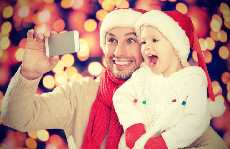 selfe  in Christmas. happy family dad and daughter