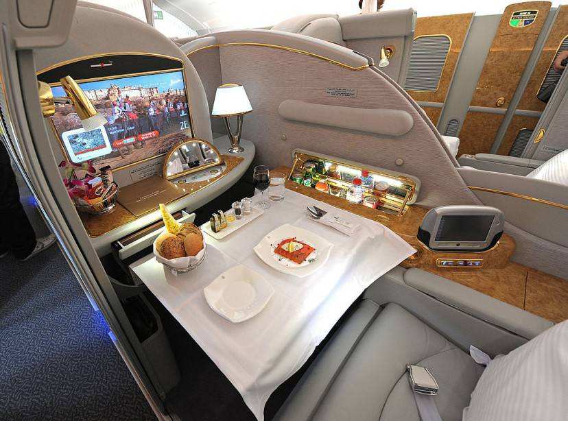 A fist class seat, set for lunch, is pictured on the upper deck of an Emirates Airbus A380, after it landed at Manchester Airport in Manchester, north-west England on September 1, 2010.   Manchester is the second airport in UK to start accepting the Airbus, after London Heathrow.     AFP PHOTO/ANDREW YATES (Photo credit should read ANDREW YATES/AFP/Getty Images)