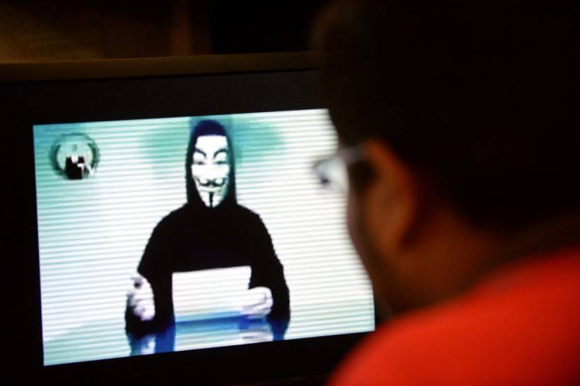"A person claiming to speak for activist hacker group Anonymous is seen issuing a warning throught a video circulated online to ""go to war"" with the Singapore government over recent Internet licensing rules on November 1, 2013.  Activist group Anonymous hacked a Singapore newspaper website on November 1 and threatened wider cyber attacks over Internet freedom, with government agencies reportedly on alert after the group said it would ""wage war"" with the city-state.      AFP PHOTOROSLAN RAHMAN        (Photo credit should read ROSLAN RAHMAN/AFP/Getty Images)"