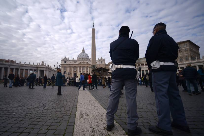 Policemen patrol during Pope Francis Angelus prayer on St Peter's square, on December 6, 2015 at the Vatican.  AFP PHOTO / FILIPPO MONTEFORTE / AFP / FILIPPO MONTEFORTE        (Photo credit should read FILIPPO MONTEFORTE/AFP/Getty Images)