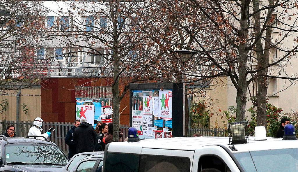 """A forensic expert and a police car are seen outside Jean-Perrin nursery school on December 14, 2015, in Aubervilliers, a suburb northeast of Paris, where a teacher was attacked in the morning by a man wielding a box cutter and scissors who cited the Islamic State (IS) jihadist group, sources in the police and prosecutor's office said. The 45-year-old teacher was stabbed in the side and throat while preparing for his class at the school, but his life was not in danger, a police source said. The assault comes after the Islamic State in November urged its followers to kill teachers in the French education system for teaching secularism and being """"in open war against the Muslim family"""". / AFP / JACQUES DEMARTHON        (Photo credit should read JACQUES DEMARTHON/AFP/Getty Images)"""