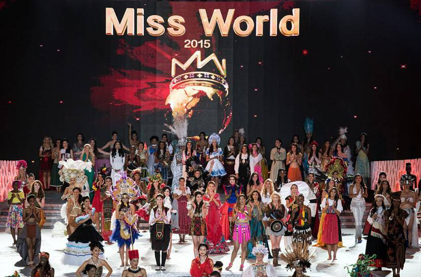 Miss World contestants perform at the Miss World Grand Final in Sanya, southern China's Hainan province on December 19, 2015. Contestants from over 110 countries compete in the final of the 65th Miss World Competition. AFP PHOTO / JOHANNES EISELE / AFP / JOHANNES EISELE (Photo credit should read JOHANNES EISELE/AFP/Getty Images)