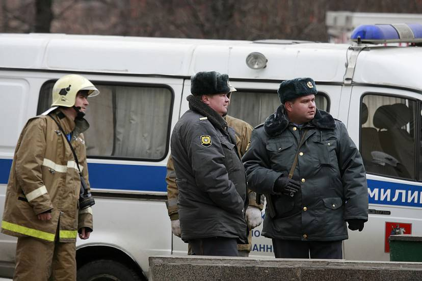 MOSCOW, RUSSIA - MARCH 29: Russian policemen are seen in front of the Lubyanka metro station entrance on March 29, 2010 in Moscow, Russia. At least 35 people were killed as two separate female suicide bombers blew themselves up on trains on Moscow's metro during morning rush hour. Twenty-Three people died in the Lubyanka station blast and around 40 minutes later a second explosion occurred at the Park Kultury station leaving another 12 people dead.  (Photo by Dmitry Korotayev/Epsilon/Getty Images)