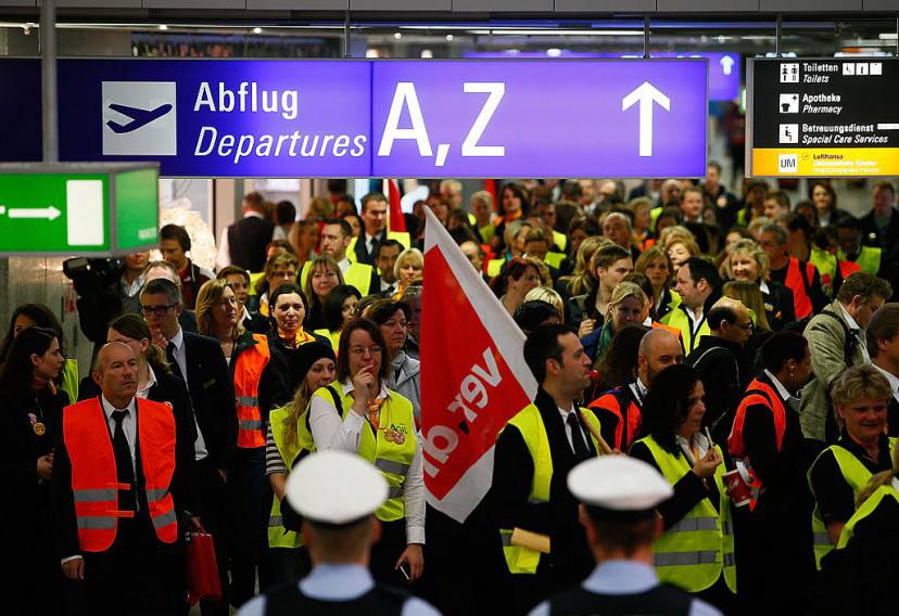 FRANKFURT AM MAIN, GERMANY - APRIL 22:  Lufthansa ground, service and maintenance personnel protest during a nationwide strike at Frankfurt Airport on April 22, 2013 in Frankfurt, Germany. Workers are demaning pay raises and job guarantees and today's strike has forced Lufthansa to cancel approximately 1700 flights.  (Photo by Ralph Orlowski/Getty Images)