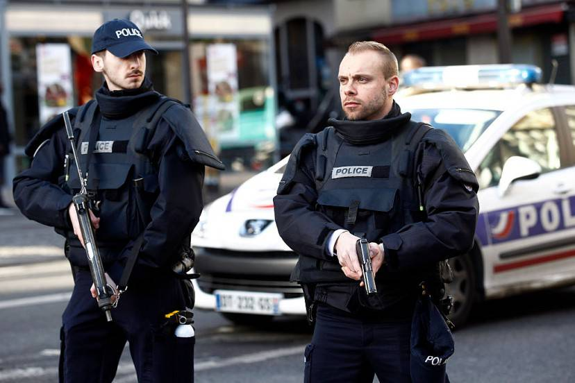 PARIS, FRANCE - JANUARY 07: Armed French police patrol near the Boulevard de Barbes in the north of Paris on January 7, 2016 in Paris, France. French police have shot dead a man as he attempted to gain access to a Paris police station whilst brandishing a knife. It is believed that the man was wearing a fake suicide vest and bomb disposal experts were brought in to investigate. The incident comes on the first anniversary of the Charlie Hebdo terrorist attacks. (Photo by Thierry Chesnot/Getty Images)