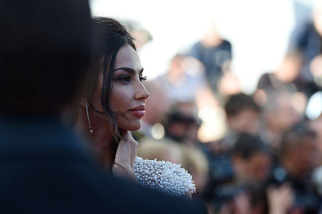 """Romanian actress Madalina Ghenea poses as she arrives for the screening of the film """"Youth"""" at the 68th Cannes Film Festival in Cannes, southeastern France, on May 20, 2015.      AFP PHOTO / ANNE-CHRISTINE POUJOULAT        (Photo credit should read ANNE-CHRISTINE POUJOULAT/AFP/Getty Images)"""