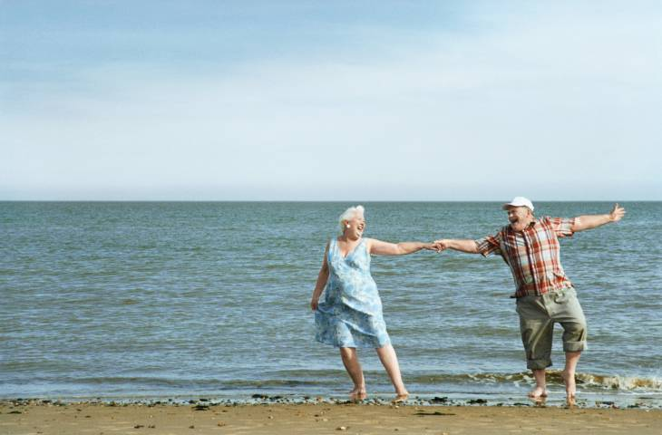 Senior Couple Dancing at Water's Edge