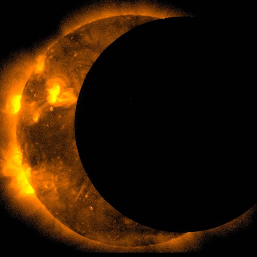 IN SPACE - MAY 20:  In this handout provided by NASA, sun spots are seen as the moon moves into a partial eclipse position after reaching annularity during the first annular eclipse seen in the U.S. since 1994 on May 20, 2012.  Differing from a total solar eclipse, the moon in an annular eclipse appears too small to cover the sun completely, leaving a ring of fire effect around the moon. The eclipse is casting a shallow path crossing the West from west Texas to Oregon then arcing across the northern Pacific Ocean to Tokyo, Japan.  (Photo by JAXA/NASA/Hinode via Getty Images)