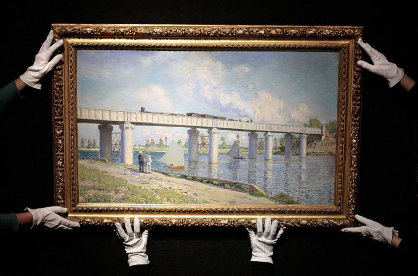 Christie's employees hold a painting entitled 'Le Pont du chemin de fer ? Argenteuil' by French artist Claude Monet at Christie's auction house in London, on February 22, 2008. The painting is estimated to fetch GBP 175m (USD 350m or Euros 230m) when it is auctioned at the Evening Sale of Impressionist and Modern Art in New York, on May 6, 2008. AFP PHOTO/SHAUN CURRY (Photo credit should read SHAUN CURRY/AFP/Getty Images)