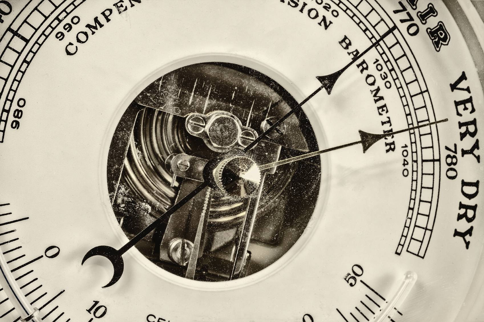 Retro styled close up image of an old barometer