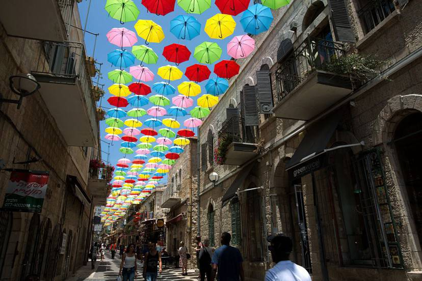 Some 1000 coloured umbrellas decorate a main pedestrian street in Jerusalem on June 30, 2015, as the city's municipality opens more attractions and cultural activities in an effort to bring tourists and locals to visit the city. AFP PHOTO/MENAHEM KAHANA        (Photo credit should read MENAHEM KAHANA/AFP/Getty Images)