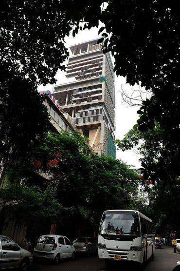 The twenty-seven storey Antilia, the newly-built residence of Reliance Industries chairman Mukesh Ambani, is seen in Mumbai on October 19, 2010. The 400,000 square foot residence, named after a mythical island in the Atlantic, is expected to be occupied by Ambani, his wife and three children later in the year. The building has three helicopter pads, underground parking for 160 cars, and requires some 600 staff to run. AFP PHOTO/Indranil MUKHERJEE (Photo credit should read INDRANIL MUKHERJEE/AFP/Getty Images)